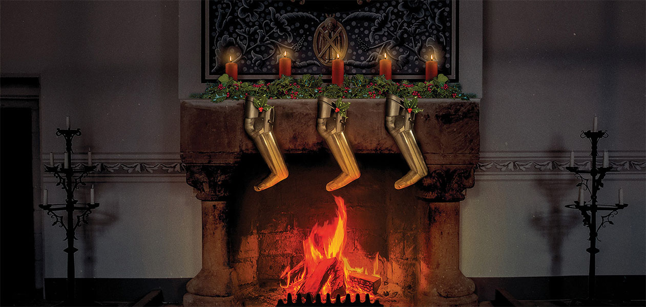 Fire roaring in the royal palace with candles on the fireplace and leg armour hanging like Christmas stockings